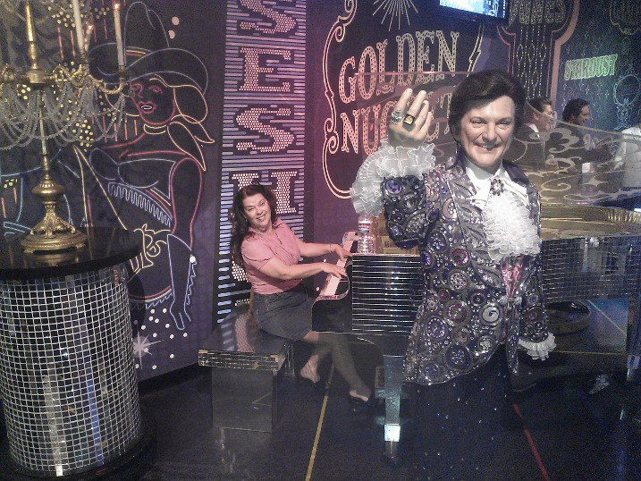 Debra K. Stevens plays for Liberace at Madame Tussard's in Las Vegas.