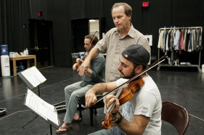 "Jim Apperson coaches Pasha Yamotahari on how to properly bow a violin during a rehearsal for Actors Theatre's ""Opus."" (Photo by Molly J. Smith, Arizona Republic)"