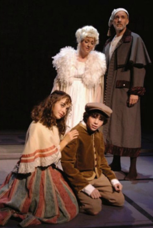 "Chelsea Grohen and Sam Bartlett, with Maria Amorocho and Kim Bennett in the 2009 edition of ""A Christmas Carol"" at Actors Theatre. (Photo credit unknown)"