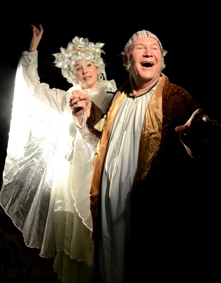 "Erica Connell is the Ghost of Christmas Past and David Vining is Scrooge in ""A Christmas Carol"" at Southwest Shakespeare Company. (Photograph courtesy of the company.)"