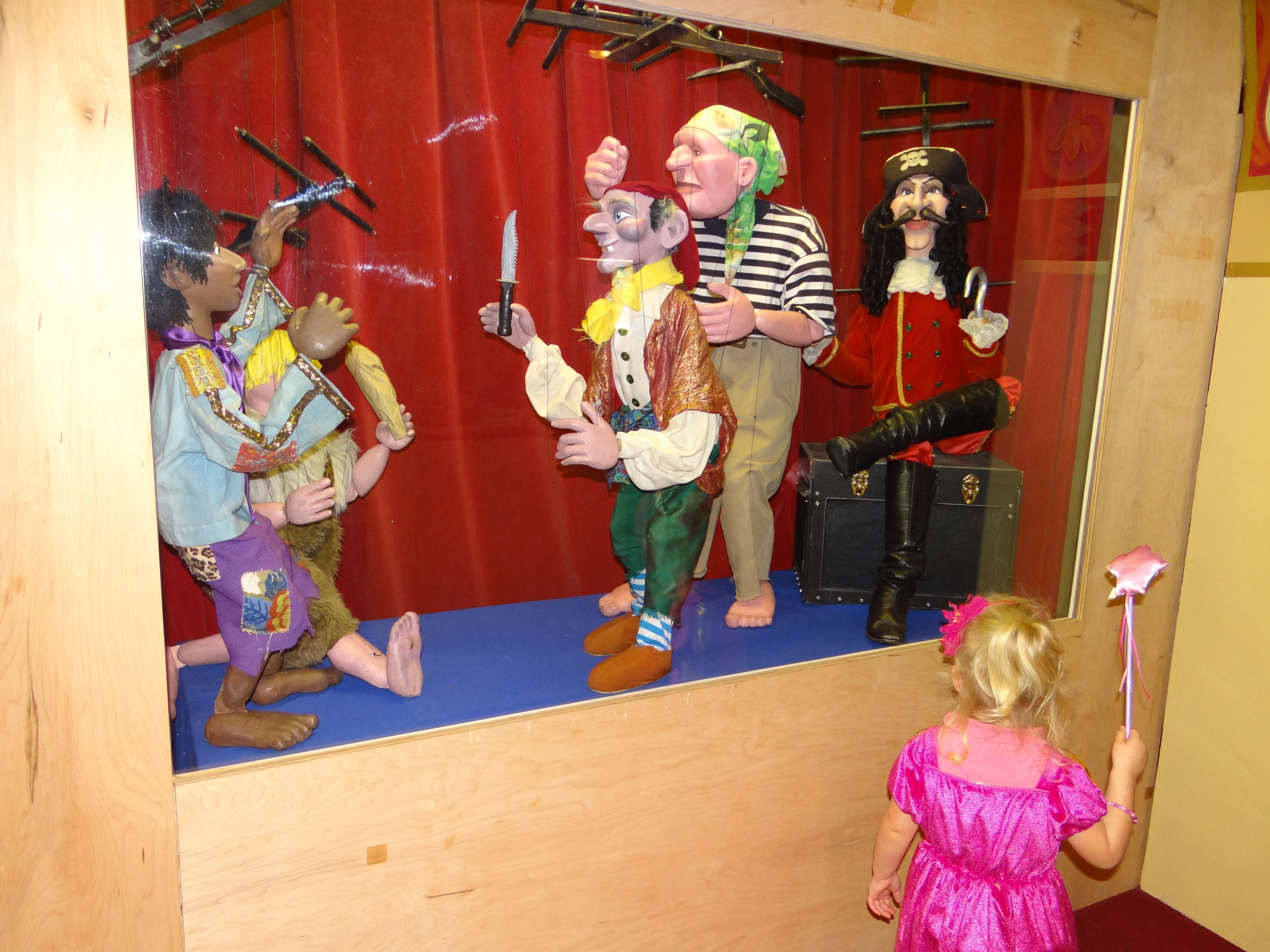 A puppet museum is housed within the theater's home building.
