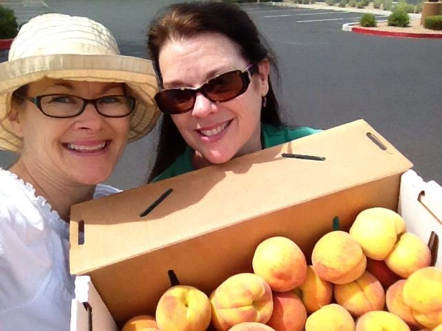 Jodie Weiss and Debra K. Stevens do a little shopping - Arizona peach on the left, Tennessee peach on the right.