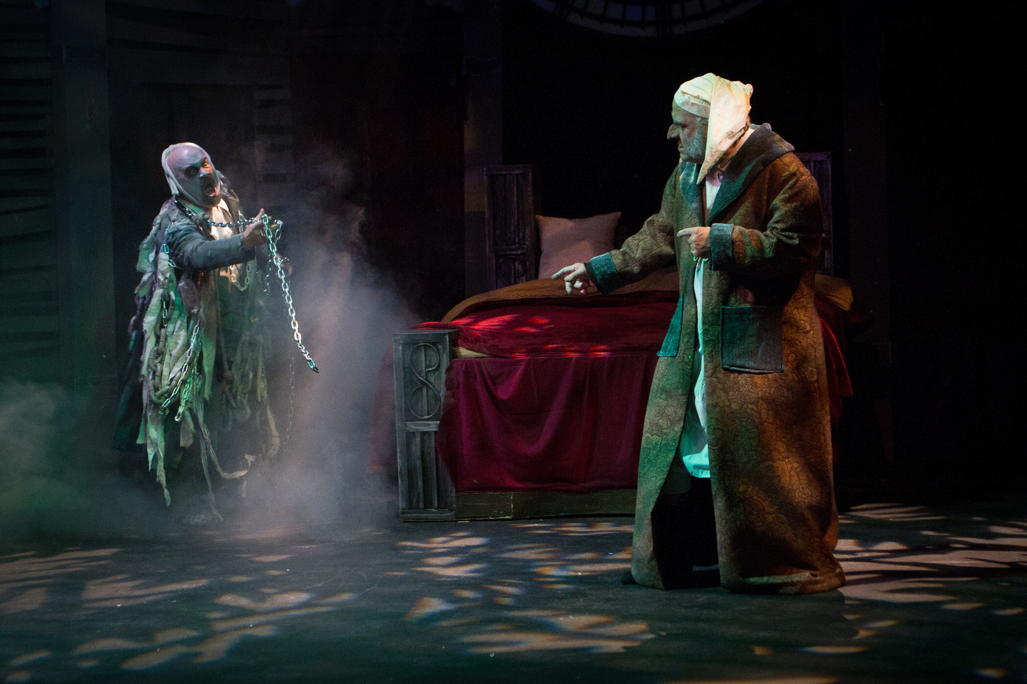 "Marley and Scrooge face off in ""A Christmas Carol."""
