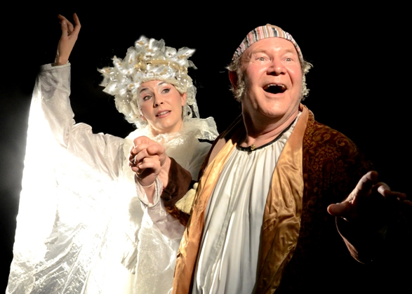 Ghost of Christmas Past (Erica Connell) gives Ebenezer Scrooge (David Vining) a much-needed nudge into the land of happy memories, in A Christmas Carol. (Photo, Southwest Shakespeare Company)