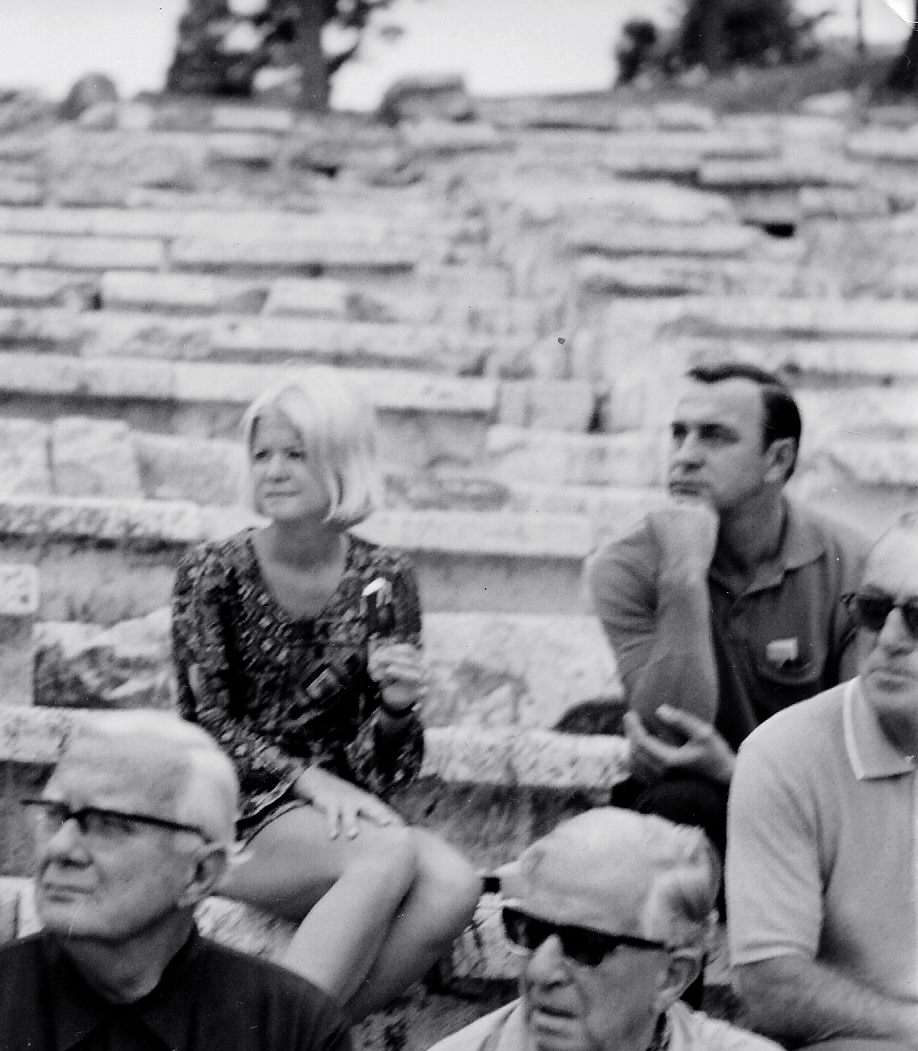During her career as an airline stewardess, Barbara Walker McBain traveled the world. Here, she is sitting on the steps of the Theater of Dionysus in Athens.