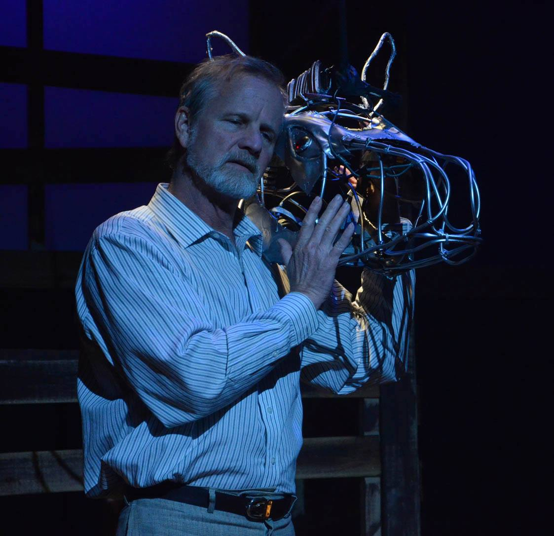 "David Weiss checks out one of the horse's heads for Nearly Naked Theatre's production of ""Equus."" (Photo Credit Needed)"