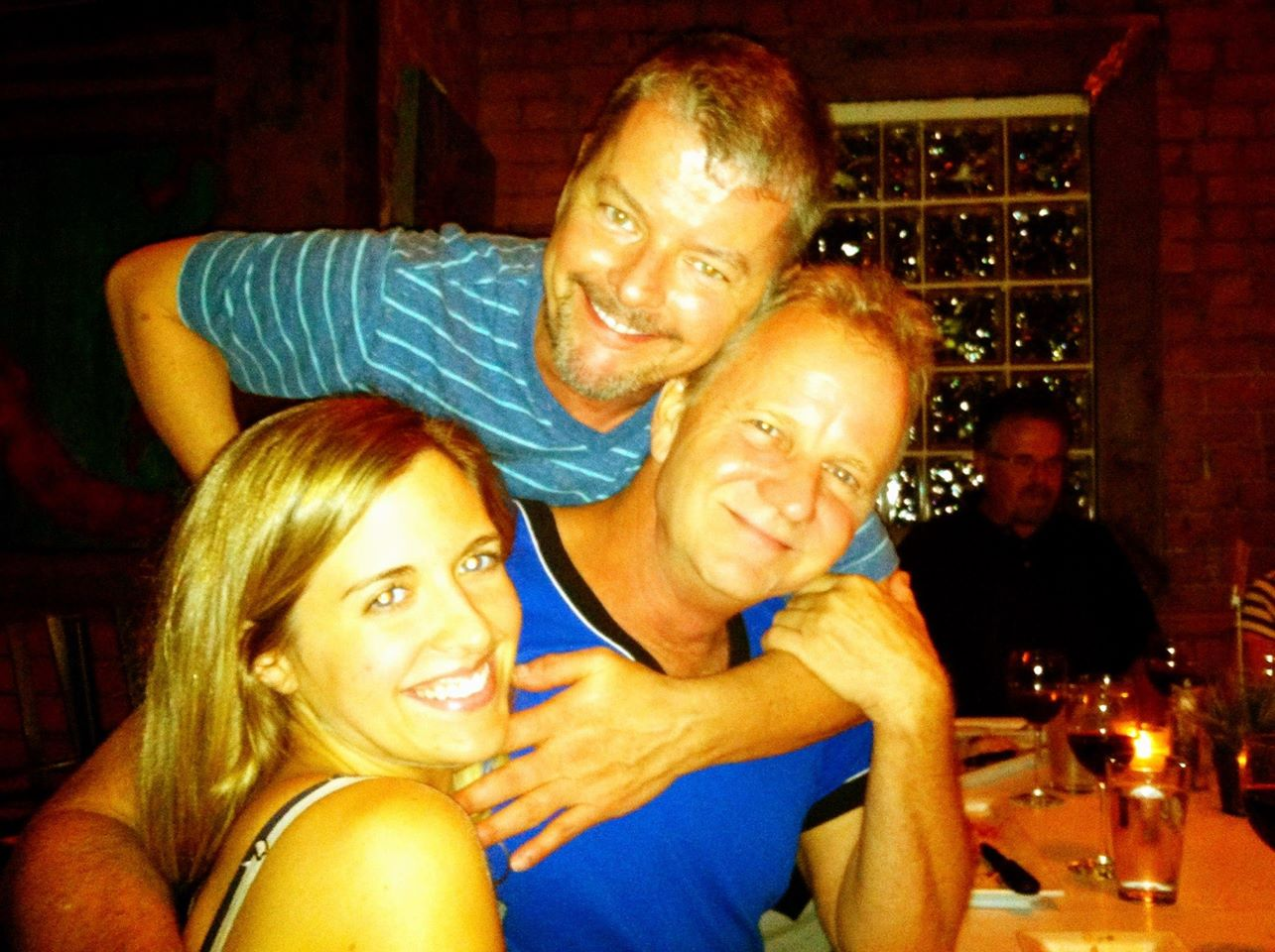 Julia Alexandra, Eric Chapman and David Weiss enjoy dinner. (Photo credit needed)