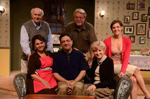 "The cast of Joe DiPietro's ""Over the Woods"" at Theatre Artists Studio, 2013, are: Back Row - Bob Barr, Michael Fleck; seated on couch - Dolores D'Amore Goldsmith, Scott Hyder, Judy Rollings, Shana Rebilas Brousard. (Photo by Mark Gluckman)"