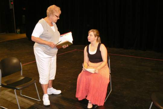 "Pam Fields, at left, founder of Scottsdale Conservatory Theatre's production of ""The Good Doctor,"" rehearses a scene with participant Sarah Zorman. (Photo by Brett Nachman)"