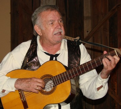 "Sandy Gibbons croons a few tunes during his stint as Honest John in ""Murder at the High Noon Saloon"" at Rawhide in 2011. (Photo credit unknown)"