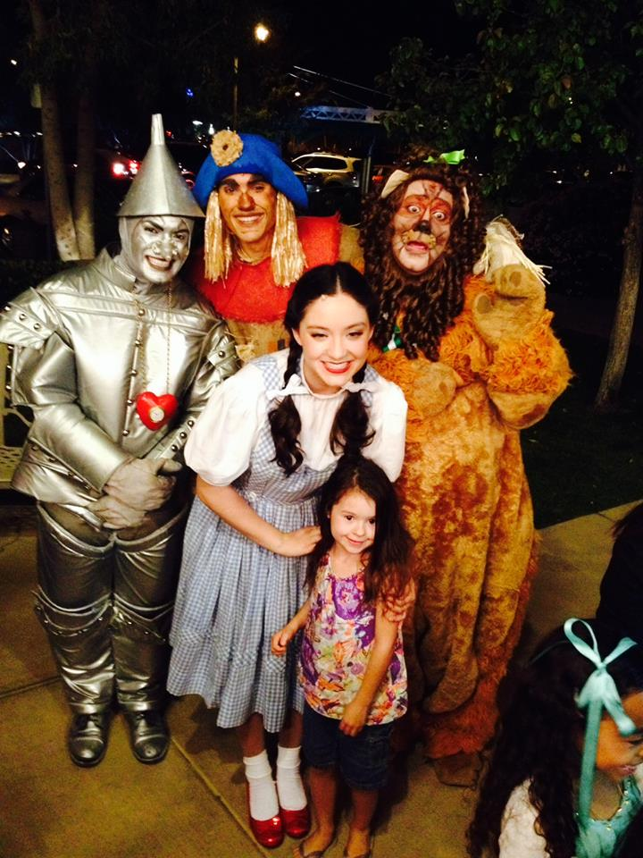 "2015. Jesse Jo Pauley is surrounded by cast members of ""The Wizard of Oz"" at Hale Centre Theatre. Vinny Chavez is the Tinman, Jesse Thomas Foster is Scarecrow and Geoff Goorin is the Cowardly Lion. (Facebook Photo)"