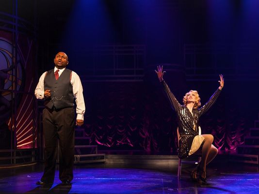 Phoenix Theatre. 2015. Chicago. Walter Belcher as Billy Flynn and Kate E. Cook as Roxie Hart. (Photo by Erin Evangeline Photography)